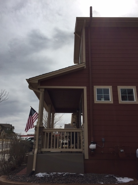 exterior of home with a radon mitigation installed