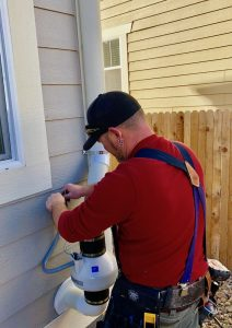 John Cardos owner of American Radon LLC installs a radon mitigation system in Westminster, CO