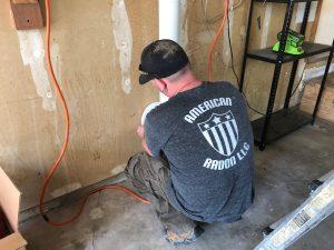 john cardos of american radon at work installing radon mitigation in windsor