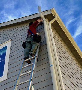 John Cardos installs a radon mitigation system in Lakewood, CO
