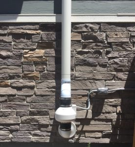radon mitigation in timnath system on exterior of local home
